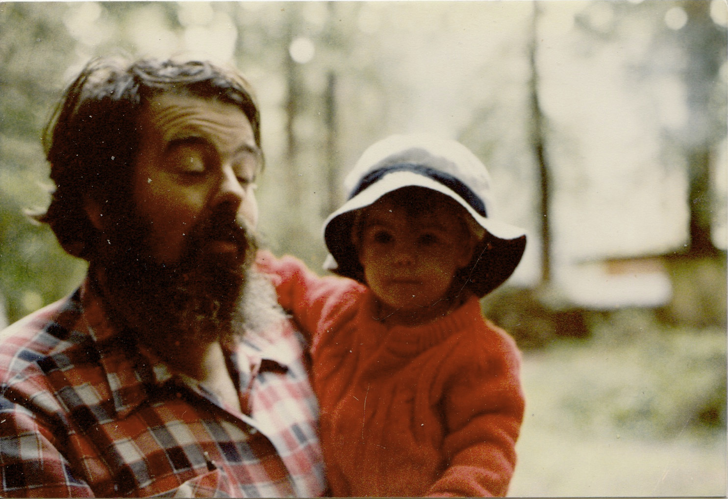 Dad holding Mel as a kid