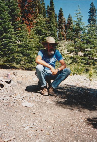 Dad squatting in woods