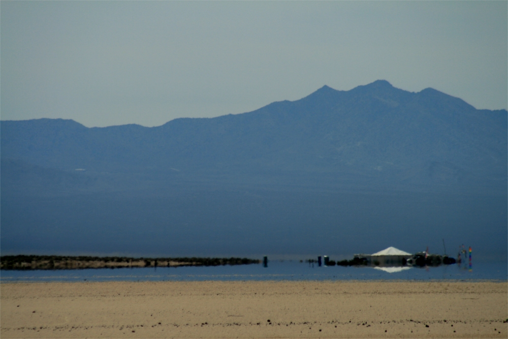 A mirage on the Mojave Desert, looking like water in the distance.