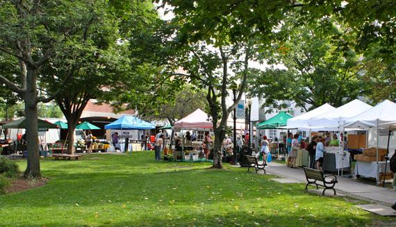 A bunch of booths at the Burlington Farmer's Market in City Hall Park, Burlington, Vermont.