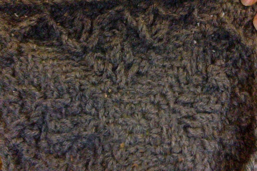 A tightly wovn grey fabric.