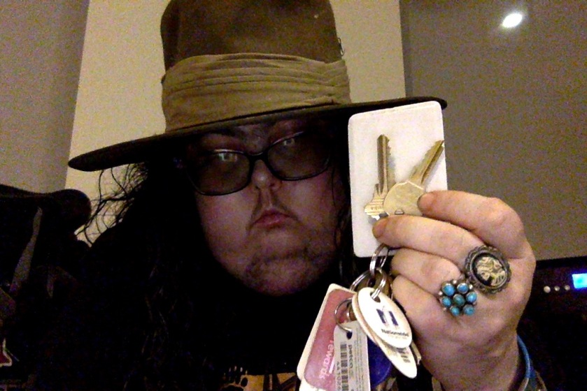 Mel holding up a set of house keys.