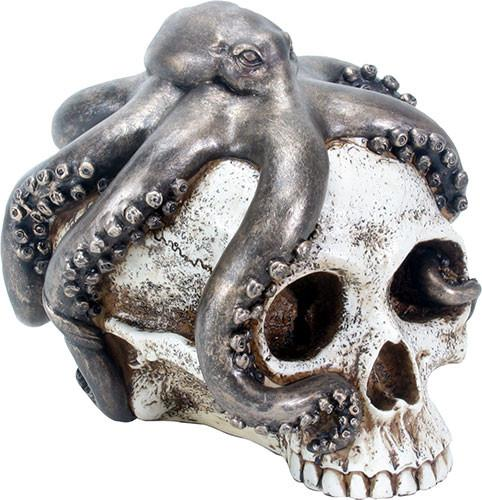 A sculpture of a skull with an octopus sitting on it.